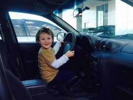 Little Man sitting in Daddy's Pontiac one last time!