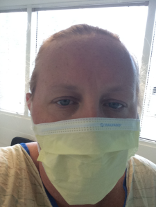 I'm looking stylish in my mask and hospital gown, right?